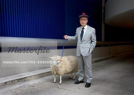 700-00609359em-man-with-sheep-on-leash.jpg